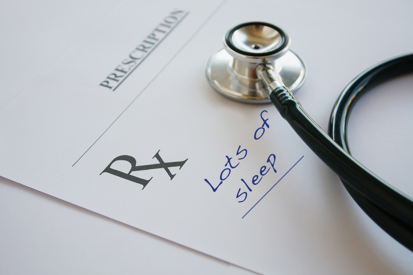 Prescription form lying on table with stethoscope